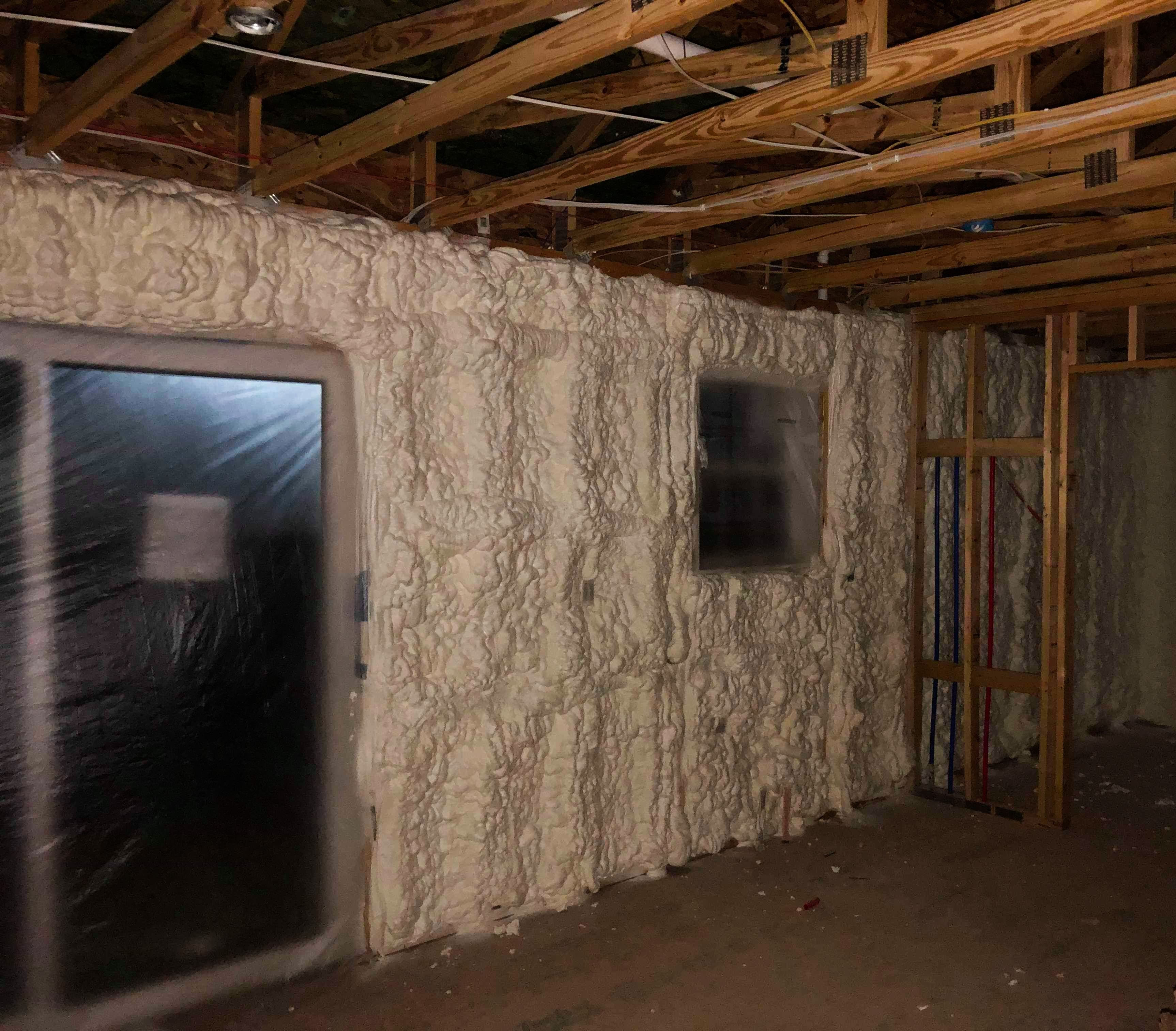 Insulated wall cavities with spray foam insulation